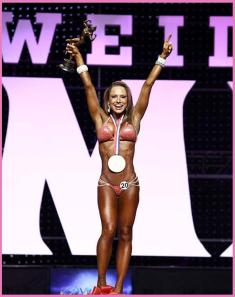2012-Bikini-Olympia-Champion-With-Pink-Background